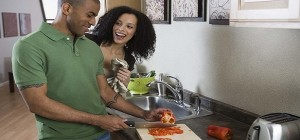 black man cooking husband