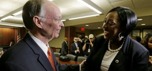 Governor Robert Bentley congratulates Dr. Gwendolyn Boyd after the Alabama State University Board of Trustees offered her the presidency of the university on Friday, Dec. 20, 2013, on the campus of ASU in Montgomery.