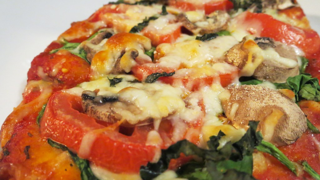Then everybody just builds the pizza to their soul's content. This had a bunch of pesto on the crust as the sauce, then the veggies and cheese on top. Stick 'em back into the oven just long enough for the toppings to bubble up and the flatbread to crisp just a bit.
