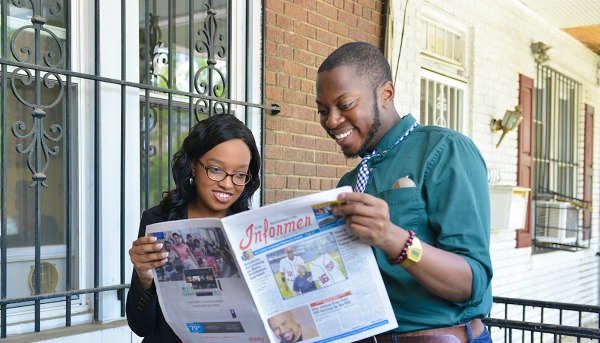 Victoria Jones (left) and Rushawn Walters, the NNPA/DTU journalism fellows assigned to The Washington Informer check out a copy of newspaper at The Washington Informer office in Southeast, Washington, D.C. (Freddie Allen/AMG/NNPA)