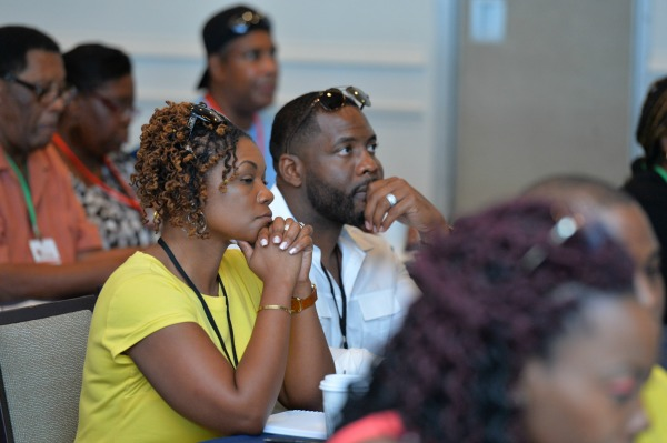 "Couples listen intently during the ""How to Establish Financial Intimacy"" panel discussion sponsored by Wells Fargo at the kickoff session of the 3rd Annual BMWK Marriage Cruise in Fort Lauderdale, FL on July 29, 2017."